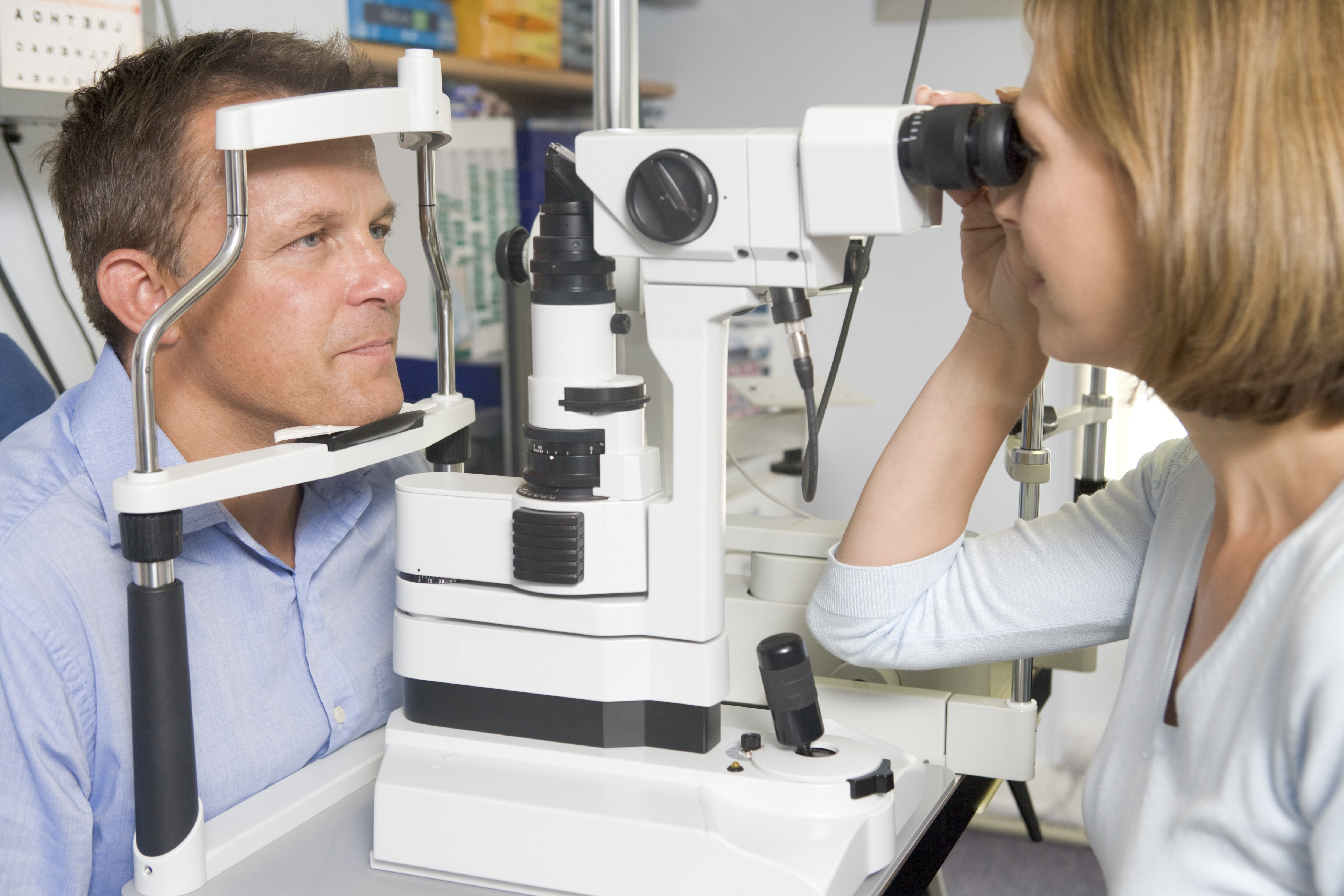 Bigstock_ 58477976 - Optometrist In Exam Room With Man In Chair.jpg